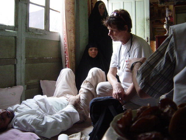 MSF anesthesist in consultation with a patient in Showaka Nabe.