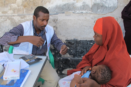 MSF doctor examining IDP child.