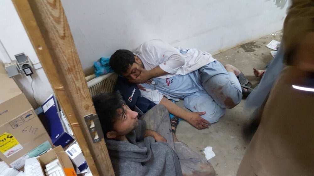 MSF staff in shock in one of the remaining parts of MSF's hospital in Kunduz, in the aftermath of sustained bombing 03 October 2015. Photo: ©MSF