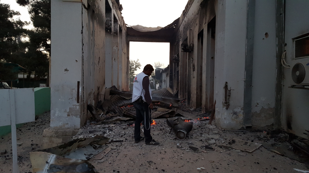 An MSF staff member walks through the grounds of the Kunduz trauma centre, 03 October, hours after it was badly damaged from sustained bombing on Saturday October 3.